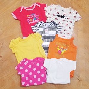 Lot of 7 onesies. Size 0-3 & 3 months.